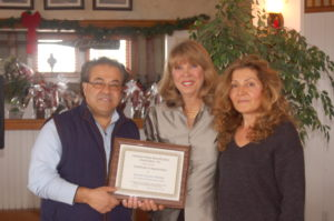 Mr. & Mrs. Tony Nurel receiving the Beautification Award for their new store